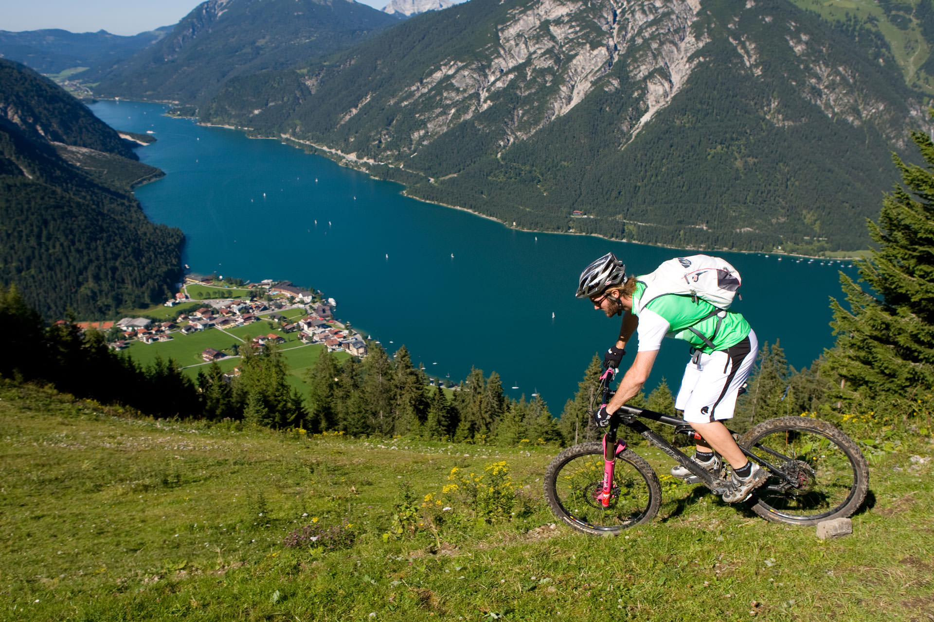 Mountain biker in the alps with lakeview