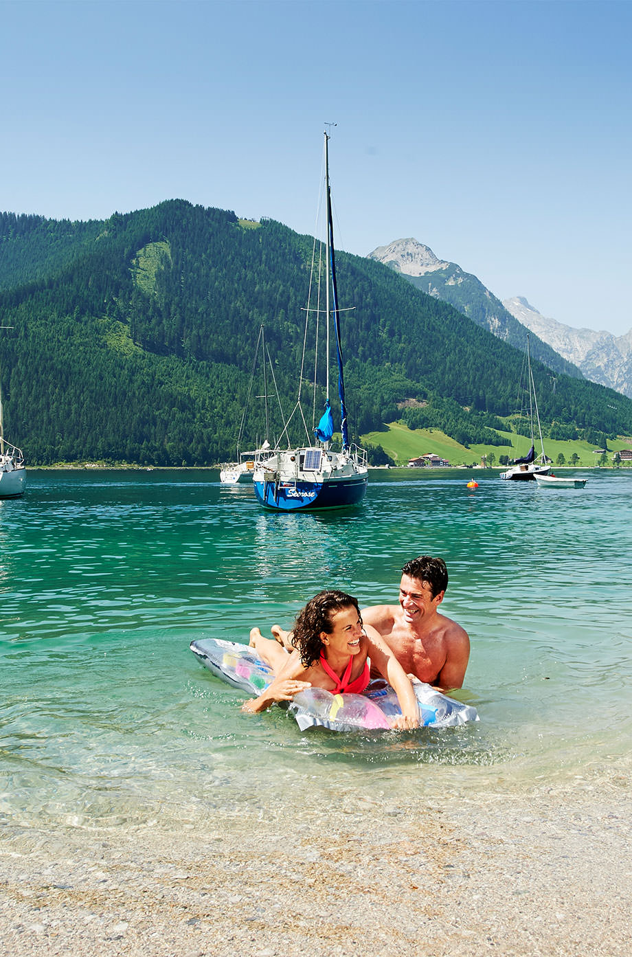 Couple with air mattress in the Lake Achensee