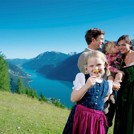 Family in traditional costume in the alps