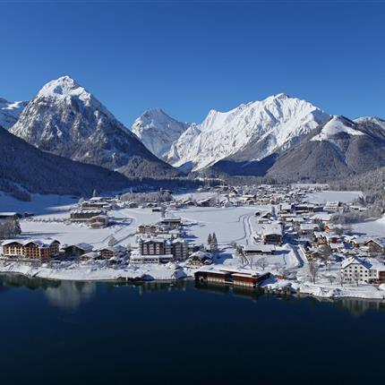 Arial view of a snow-covered village by lake