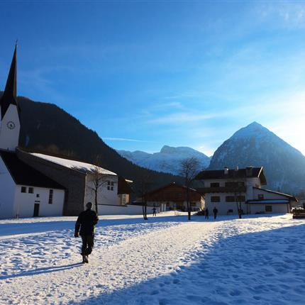 Winterly walk through snow-covered village