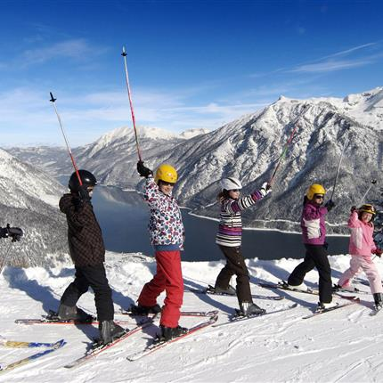 Children ski course with lakeview