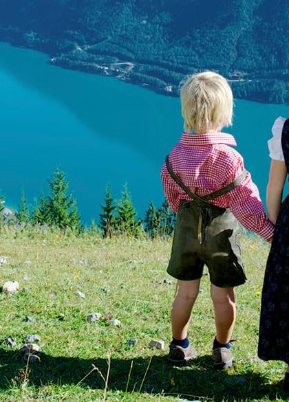 Brother and sister on mountain pasture